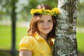 Girl in flowers wreath near birch — Stock Photo