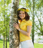 Girl in wreath near birch — Stock Photo
