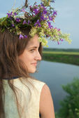 Long-haired girl in flower chaplet — Stock Photo