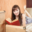 Female student reading book — Stock Photo