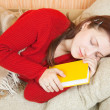 Woman sleeps with book — Stock Photo