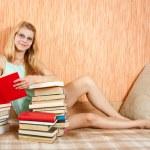 Sexy girl reading books — Stock Photo