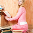 Female student reading books — Stock Photo