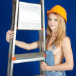sexy girl in hardhat with stepladder — Stock Photo