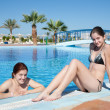 Girls in swimming pool at resort hotel — Stock Photo #3424570