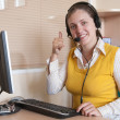 Businesswoman communicating on headset — Stock Photo