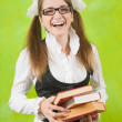 Happy schoolgirl with books - Stock Photo