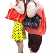 Happy casual girls with handbag — Stock Photo