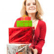 Girl with coloured present boxes — Stock Photo