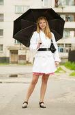 Girl with umbrella outdoors — Stock Photo