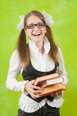 Happy schoolgirl with books — Stock Photo