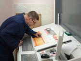 Printer testing a print run with lens — Stock Photo