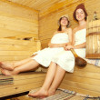 Girls on bench in sauna — Stock Photo