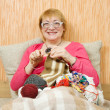 Knitting senior woman — Stock Photo