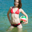 Girl with ball in lake — Stock Photo #3573937