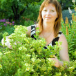 Woman gardener with  prairieweed — Stock Photo