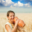 Eldery woman with jug — Stock Photo