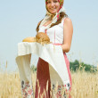 Girl with bread at field — Stock Photo