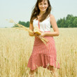 Girl with bread at field — Stock Photo #3574197