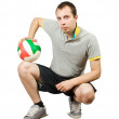 Sporty man posing with ball — Stock Photo