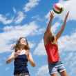 Stock Photo: Girls playing volleyball