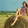 Country girl on fresh hay — Stock Photo #3575868