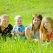 Royalty-Free Stock Photo: Happy family on grass