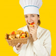 Stock Photo: Cook girl in toque with pastry