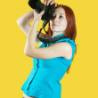 Female photographer with camera - Stock Photo