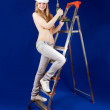 Topless woman  with drill - Stock Photo
