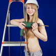 Topless girl in hard hat with drill - Stock Photo