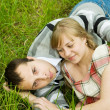 Couple resting on grass — Stock Photo