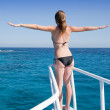 Stock Photo: Womsunbathing on ship