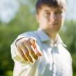 Stock Photo: Man pointing towards