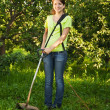 Girl works r in garden — Stock Photo