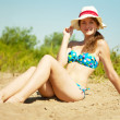 Girl  sunbathing on sand — Stock Photo