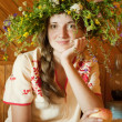 Stock Photo: Girl in flowers chaplet