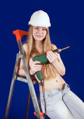Topless girl with drill — Stock Photo