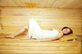 Girl on bench in sauna — Stock Photo