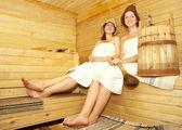 Girls on bench in sauna — Stock Photo