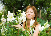Woman with lily in garden — Stock Photo