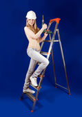 Topless woman with drill — Stock Photo