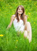 Teen girl is lying at meadow — Stock Photo