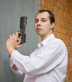 Man with gun — Stock Photo