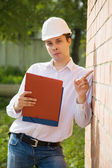 Builder in hardhat with documents — Stock Photo