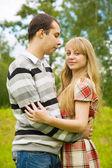 Pretty girl embracing handsome boyfriend — Stock Photo
