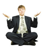 Businessman in yoga position — Stock Photo