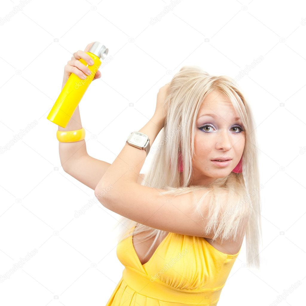 Blonde girl spraying hair lacquer onto her hair — Stock Photo #3576420