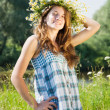 Teen girl  in camomiles chaplet - Stock Photo