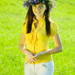 Stock Photo: Girl in flowers wreath